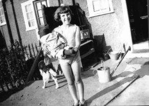 Helen in the back garden with her teddy, and Hector, Summer, Dagenham, Essex