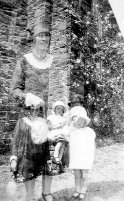 """This one shows Len & Mum together and it also shows another picture of the 3 of us together.  Daddy holding Len - note his bowler hat at the top of (your) Len's head"" - Mums annotation on back of photo"