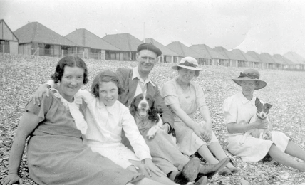 Mum, Len, Dad, Hector the dog, and possibly two cousins of Dad's from Lancacashire.  Unknown beach, but probably on the East or South East English coast