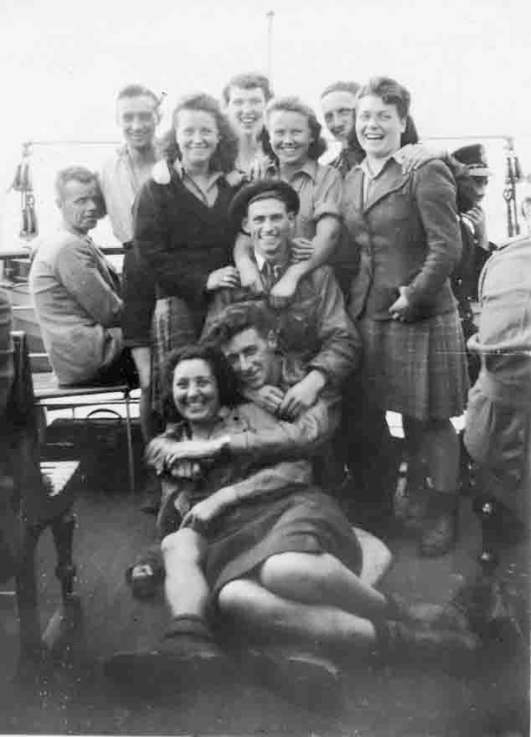 """Hiking Gang, steamer, Loch Lomond. '43""  Len's handwriting on reverse.  Len is centre back.  Joan Brandley, visiting from Dagenham, is bottom left."