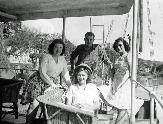 """""""Left to Right.  Moi, Doreen, Des & Joan.  The prow of the good ship.  May '46""""  Len's annotation on back of photo"""